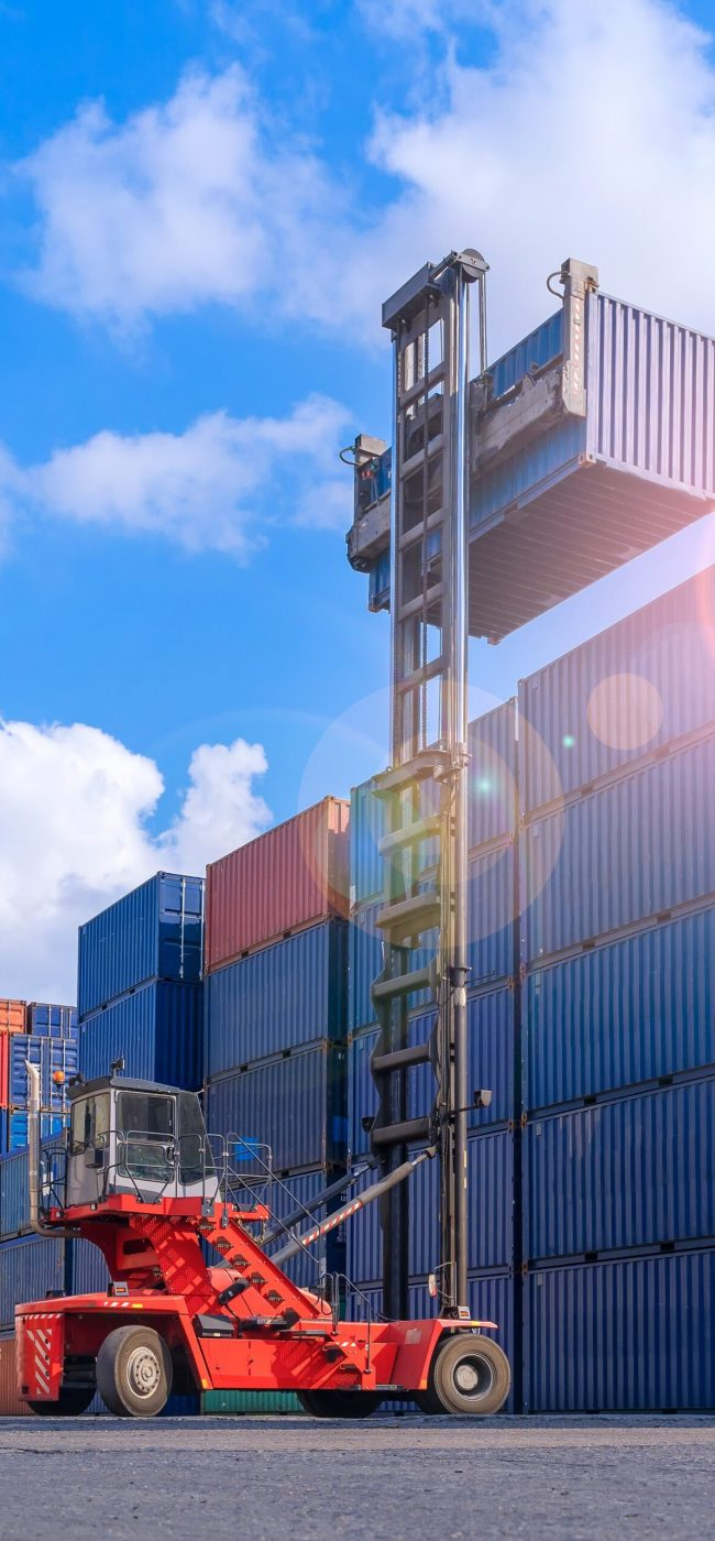 Industrial Container yard for Logistic Import Export business, Forklift truck handling cargo shipping container box in logistic shipping yard with cargo container stack, Crane lifting up container in yard